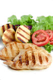 Light meal. Chicken with baked potato, lettuce and tomato Stock Images
