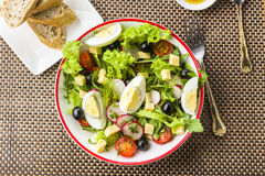 Light meal - salad with rucola. Tomato, egg and olives Royalty Free Stock Photo