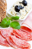 Light meal of salami, ham and feta cheese Royalty Free Stock Image