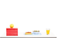 Light meal on a table with books Stock Photo
