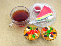 Light meal Tea and Dessert on wooden table Stock Photos