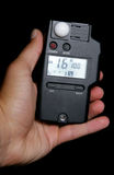 Light meter reading in studio royalty free stock photo