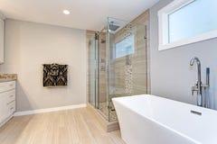 Light modern bathroom design with walk in shower stock photos