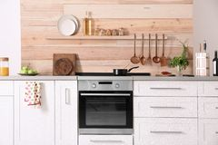 Light modern kitchen interior. With new oven royalty free stock photos