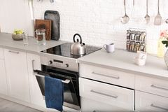 Light modern kitchen interior. With new oven stock photos