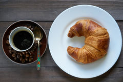 Light morning breakfast. croissant and cup of coffee espresso Stock Photo