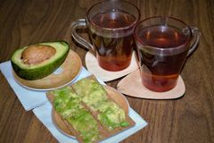 Light morning breakfast with tea ond sandwiches. stock image