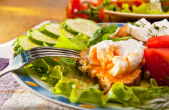 Toasted brown bread with pouched egg Stock Photo