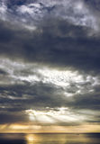 Light morning sun behind the clouds. Stock Photos