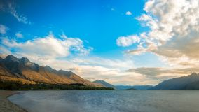 Light on the mountain at Glenorchy, New Zealand. Sunset at the Northern end of Lake Wakatipu at Glenorchy, a charming touristic village situated in Otago Region Stock Photo