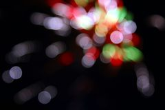 Light and movement. Blurred colourful dots against a black background Royalty Free Stock Image