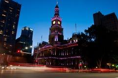 Light moving of bustling city center scene with old clock tower. Purple light moving of bustling city center scene with old clock tower in Sydney royalty free stock image