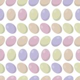 Light multi-colored Easter eggs on a white background seamless pattern. Light multi-colored shiny Easter eggs on a white background seamless pattern Royalty Free Stock Photo