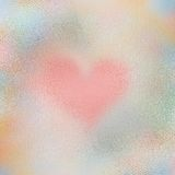 Glass heart texture. Light multicolor Frosted glass texture background with a heart design Royalty Free Stock Photo