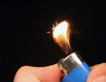 Light my fire. One way plastic lighter with flame and sparks stock image