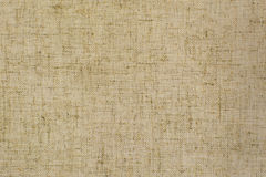 Light natural linen fabric for the background. Texture of natural raw material Royalty Free Stock Images
