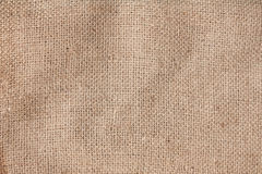 Light natural linen texture for the background. Burlap natural linen fabric texture for the background royalty free stock images