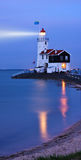 Light in the night. Illuminated lighthouse in twilight, light beam shines in dark skies Stock Photo