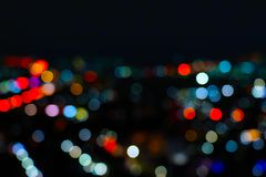 Light night city bokeh abstract background. Blurry light beautiful night city bright bokeh abstract art background defocus effect glowing on black background royalty free stock images