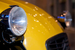 Light of an old sport car. Light of an old yellow sport car Royalty Free Stock Images
