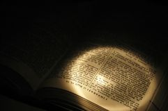 Light on open book Stock Photo