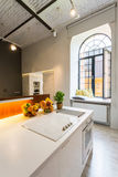 Light open kitchen with industrial look Royalty Free Stock Image