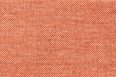 Light orange background of dense woven bagging fabric, closeup. Structure of the textile macro. Stock Photo