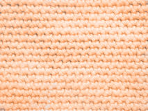 Light orange Coloured knitted Jersey as background Stock Photography