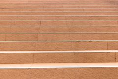 Light orange tile of stairs. Stair steps, concrete stair top up with tile stock photo