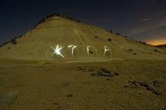 Light paining in night desert Stock Image