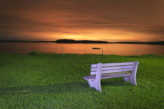 Light painted bench at sunset. Light painted technique of a white bench at night in Maine, USA royalty free stock image