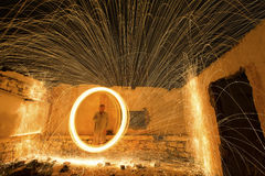 Light painting in abandon house with spinning steel wool making. Light painting in an abandon house with spinning steel wool making fire royalty free stock photo