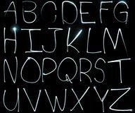 Light painting alphabet. The alphabet painted with an LED light in the air Royalty Free Stock Image