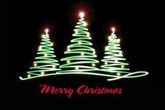 Light painting Christmas trees. With lettering Royalty Free Stock Photos