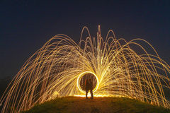 Light Painting with fire circle and two lovers Stock Photo