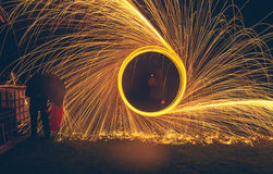 Light Painting with fire circles and umbrella Stock Photography