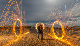 Light Painting with Fire Umbrella and Fire Circles Royalty Free Stock Photos