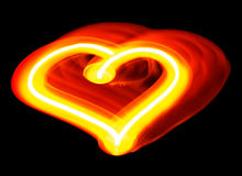 Light painting of heart. Made by moving hand-held candle isolated on black background Stock Images