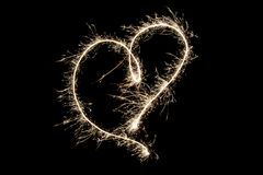 Light painting heart shape over black. Background Royalty Free Stock Images