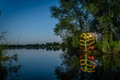 Light painting at lake Stock Photography