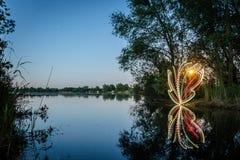 Light painting at lake Royalty Free Stock Photo