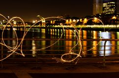 Light painting at night by the river in Puerto Madero royalty free stock image