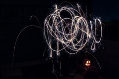 Light painting with sparklers - squiggles in colour stock photography
