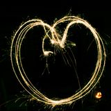 Light painting with sparklers - heart in bright colour stock photos