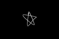 Light painting star shape. On black background Stock Image