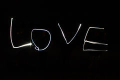 Light painting the word love. On black background Stock Photography