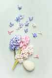 Light pastel Easter greeting card with hyacinths flowers and egg Royalty Free Stock Photos