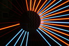 Light Patterns. Illuminated orange and blue beams of light, radiating out Royalty Free Stock Photography