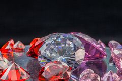 Colorful gems on black background Stock Photos