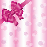 Light pink background with ribbon and bow Stock Images